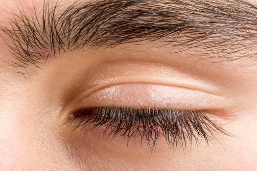 teenager man eye macro