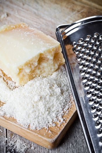 grated parmesan cheese and metal grater