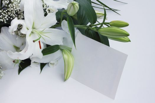 White lily flowers and post card