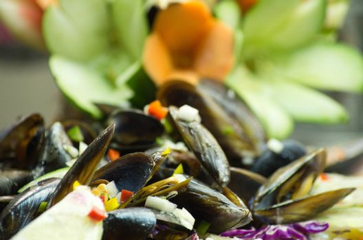 Salad from a mussel with fish and vegetables