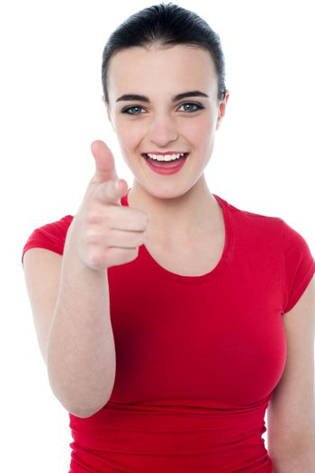 Young woman pointing her finger to you