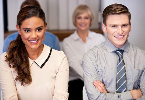 Happy business people attending meeting