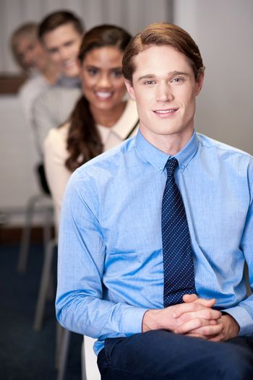 Business people sitting in meeting room
