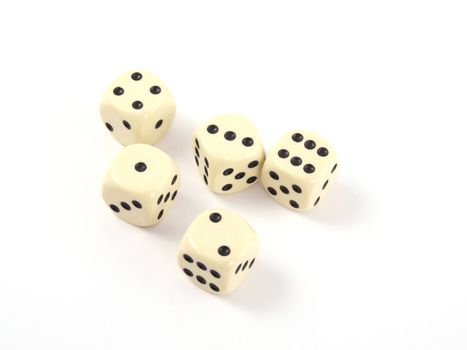 Close up photo of five dice on a white background.