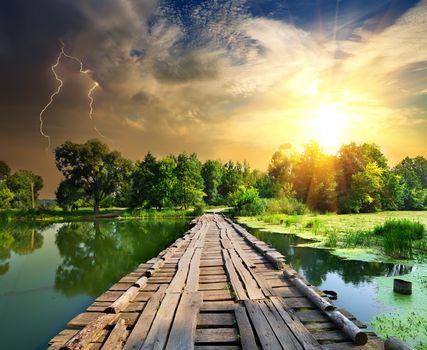 Lightning over the wooden bridge