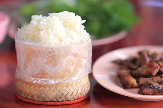 Sticky rice served in a traditional Lao and Thai woven bamboo basket