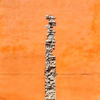 Crack of bricks in orange wall