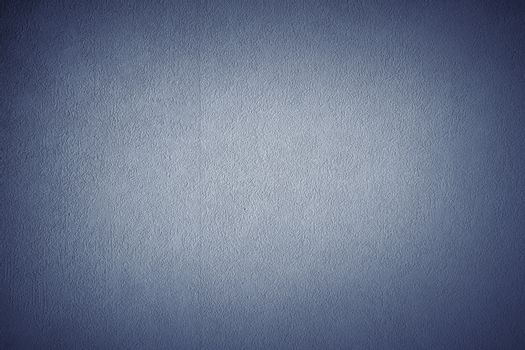 Blue grunge textured wall. Copy space