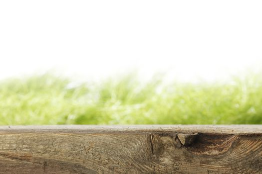 Wooden plank and grass