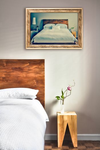 Clean and Modern Bedroom with fun Canvas on the Wall