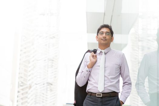 Candid Indian businessman walking