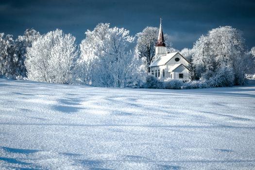 Church in winter landscape