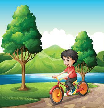 A boy biking at the riverbank