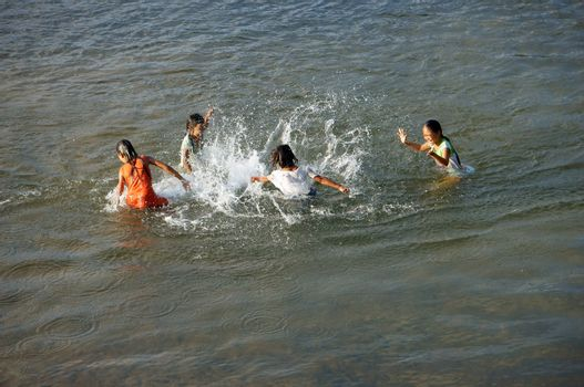 KHANH HOA, VIET NAM- FEBRUARY 5: Chidren playing, bathe in the river, this is warning about  children's drowning  situation at countryside, Khanh Hoa, February 5, 2013