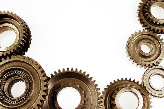 Metal cog wheels bonding together on plain background