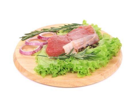 Raw beefsteak on platter.