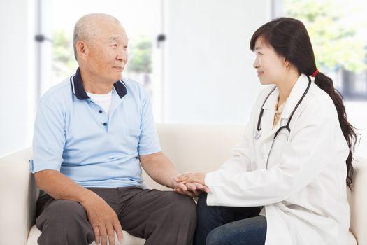 friendly doctor caring senior man indoor room