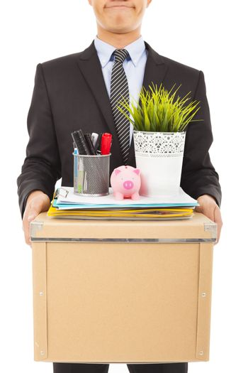 fired businessman felling sad and carrying his belongings