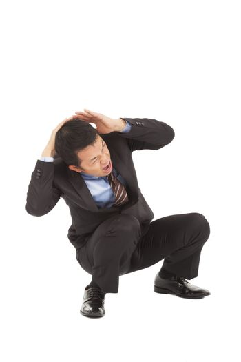businessman scared and protect his head