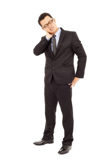 Young businessman having neck pain