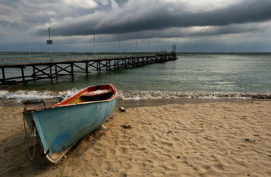 Boat on cloudy beach