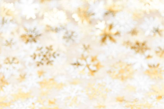 Golden abstract blurred Christmas background with snowflakes