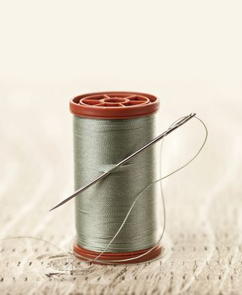 Spool of thread with needle for sewing