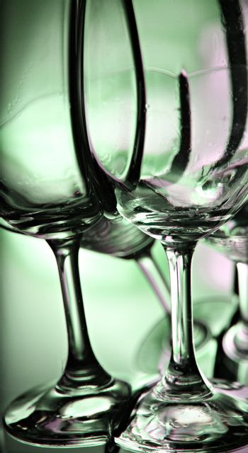 The Picture focus Green Background of wine glass this Front.