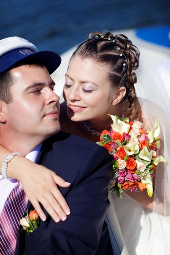 bride and groom kissing on the boat