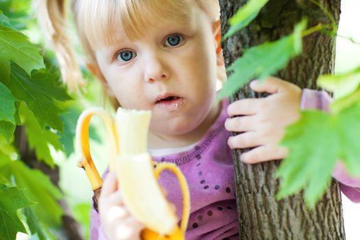 girl on the tree with banana