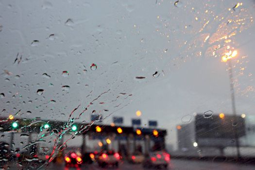 The Picture Rain on the Windshield at motorway and Traffic Jam.