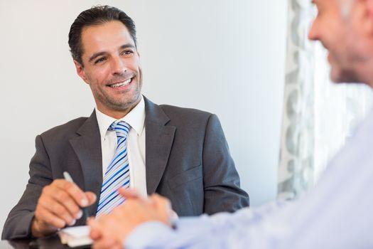Businessmen doing paperwork at desk
