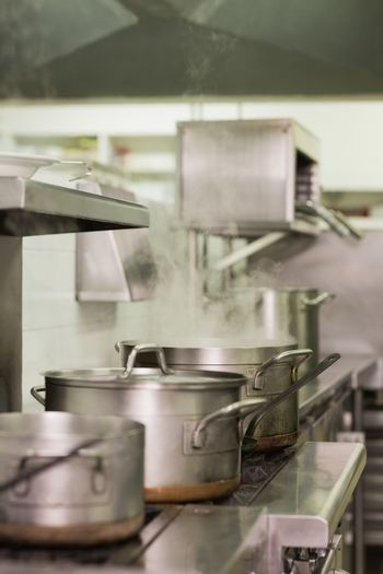 Large steaming pots on the stove