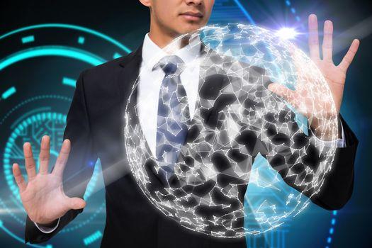 Businessman touching sphere
