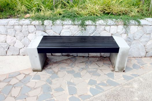 Bench in the park Designed using a combination of wood and cement.