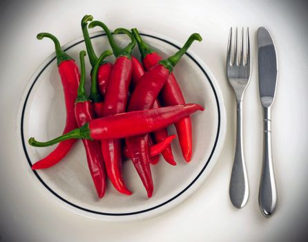 red pepper dish with cutlery