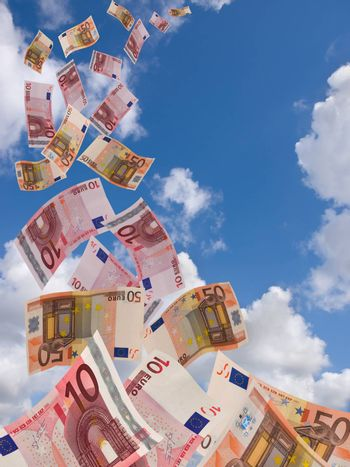 a lot of flyinq euro banknote on a sky background background