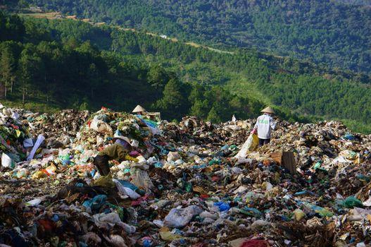 DA LAT, VIET NAM-SEPTEMBER 5: People pick up garbage at landfill in Da Lat, Viet Nam on September 5, 2013