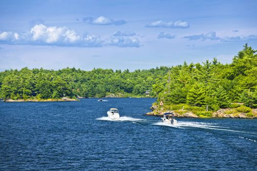 Recreational boats on blue waters of Georgian Bay near Parry Sound, Ontario Canada