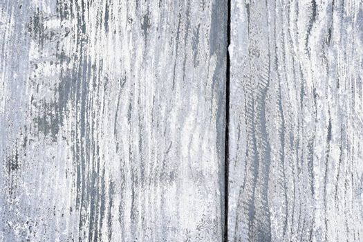 Textured background of distressed rustic wood with peeling blue and white paint