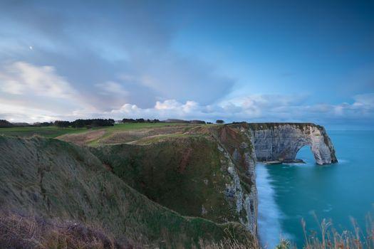 cliffs and Atlantic ocean in dusk