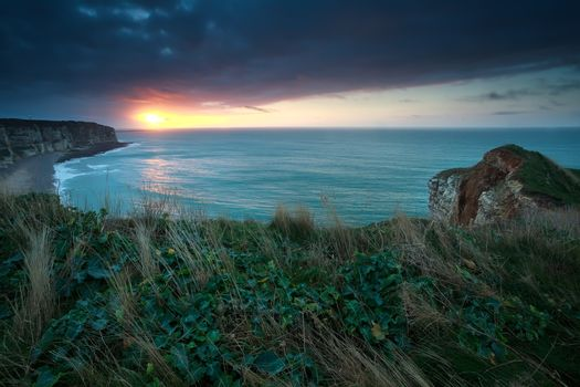 sunset over Atlantic ocean and cliffs