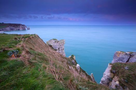 cliffs in Atlantic ocean at sunrise