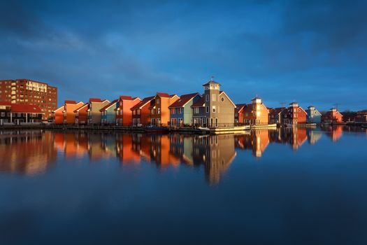 multicolor buildings on water in sunshine