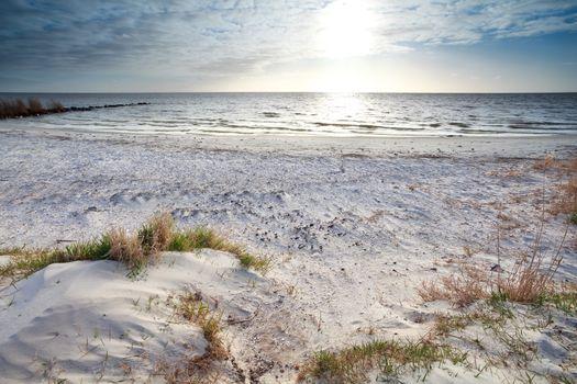 sunshine over sand beach and North sea