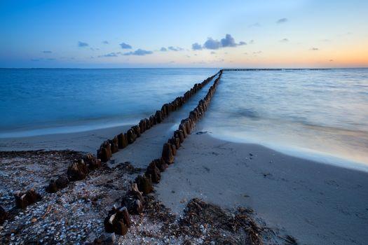 long wooden breakwater in North sea