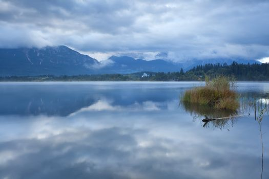 clouded sky over Barmsee lake