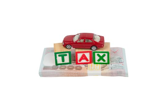 Tax block and car on money