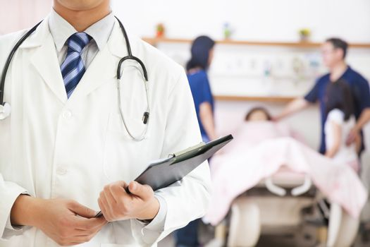 doctor holding a medical history with patient and family