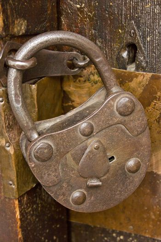 Vintage lock on a old wooden church door.